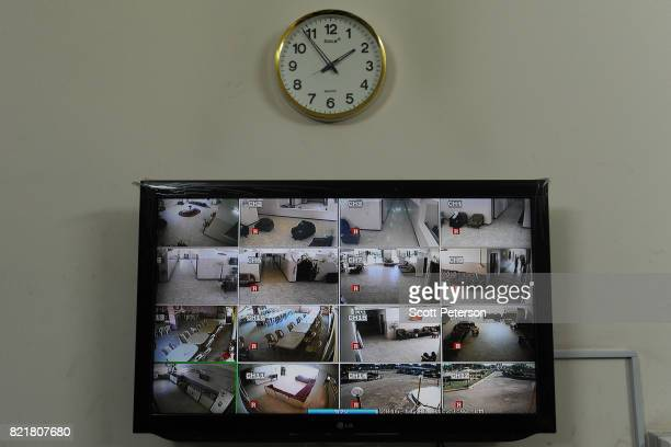 A splitscreen television with scenes from 16 monitoring cameras hangs in the director's office of the private Mercy Home for the Elderly one of the...