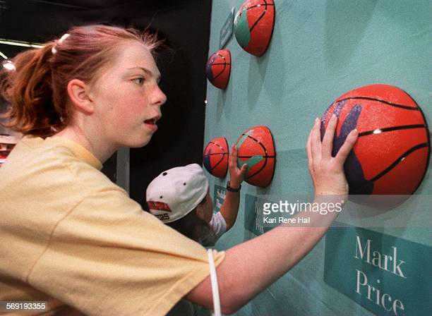 SPNationalball1KH6/27/96Jennifer Bartus of Amherst NY and her friend Erica Smrt of Belen NM compare their hand sizes to those of basketball players...