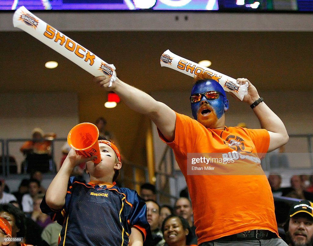 Spokane Shock fans Dakota Bauge (L) and Dan Bauge of Wahington, celebrate after the Shock scored a touchdown against the Wilkes-Barre/Scranton Pioneers during the AFL2 ArenaCup 10 at the Orleans Arena August 22, 2009 in Las Vegas, Nevada. The Shock defeated the Pioneers 74-27.