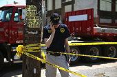 NTSB spokesmen Peter Knudson talks on his phone near Tueday's Amtrak train derailment May 14 2015 in Philadelphia Pennsylvania Today rescue workers...