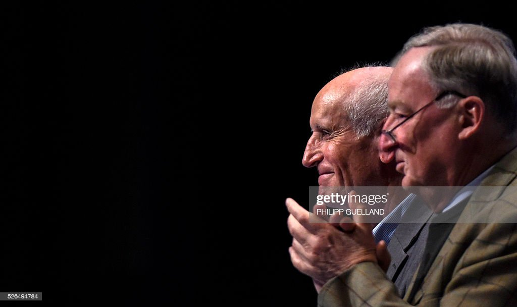 AFD spokesperson Albrecht Glaser (L) is applauded by AFD deputy chairman Alexander Gauland after being declared as the party's candidate for the presidential election 2017 during a party congress of the German right wing party AfD (Alternative fuer Deutschland) at the Stuttgart Congress Centre ICS on April 30, 2016 in Stuttgart, southern Germany. The Alternative for Germany (AfD) party is meeting in the western city of Stuttgart, where it is expected to adopt an anti-Islamic manifesto, emboldened by the rise of European anti-migrant groups like Austria's Freedom Party. / AFP / Philipp GUELLAND