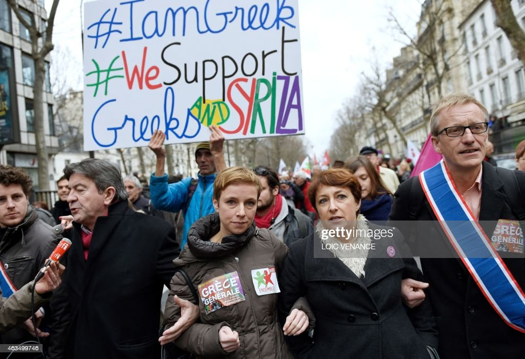 Spokesperson of French Left party Ensemble (Together) Clementine Autain (C) marches during a demonstration in support of the Greek people on February 15, 2015 in Paris. At least 2,000 people marched through the streets of Paris on February 15 heeding the call from unions and far-left organisations to voice their support for Greece and its new leftist anti-austerity government. AFP PHOTO / LOIC VENANCE