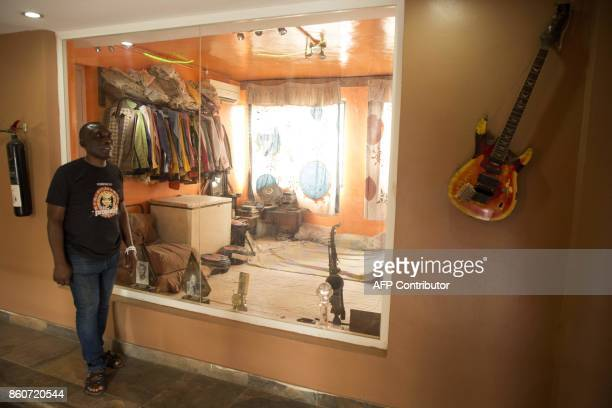 Spokesperson of The Kalakuta Museum in Lagos Abdul Okwechime walks past The collection Showroom where items belonging to the pioneer of the Afrobeat...