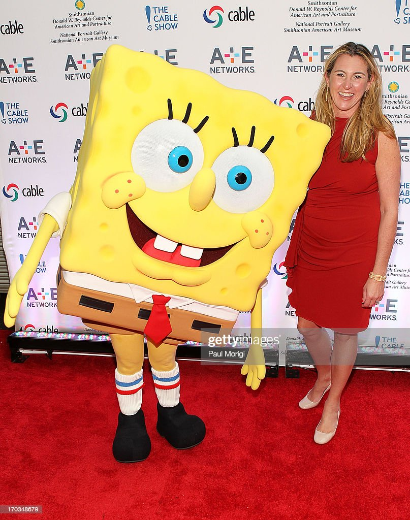 Sponge Bob (L) and Nancy Dubuc, President and CEO, A+E Networks, pose for a photo at the A+E hosted NCTA Chairman's Reception at Smithsonian American Art Museum & National Portrait Gallery on June 11, 2013 in Washington, DC.