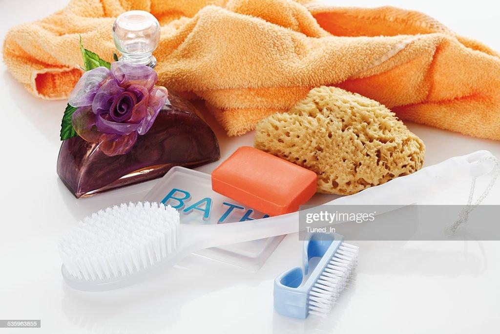 Sponge, soap and bath oil against white background : Stock Photo