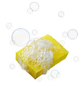 yellow sponge with lots of soaps and bubbles