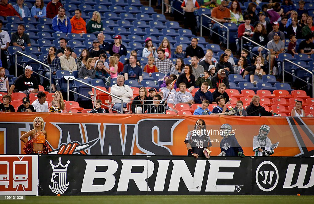 Sponsor signage and fans at the Denver Outlaws versus Rochester Rattlers game at Sports Authority Field at Mile High on May 18 2013 in Denver...