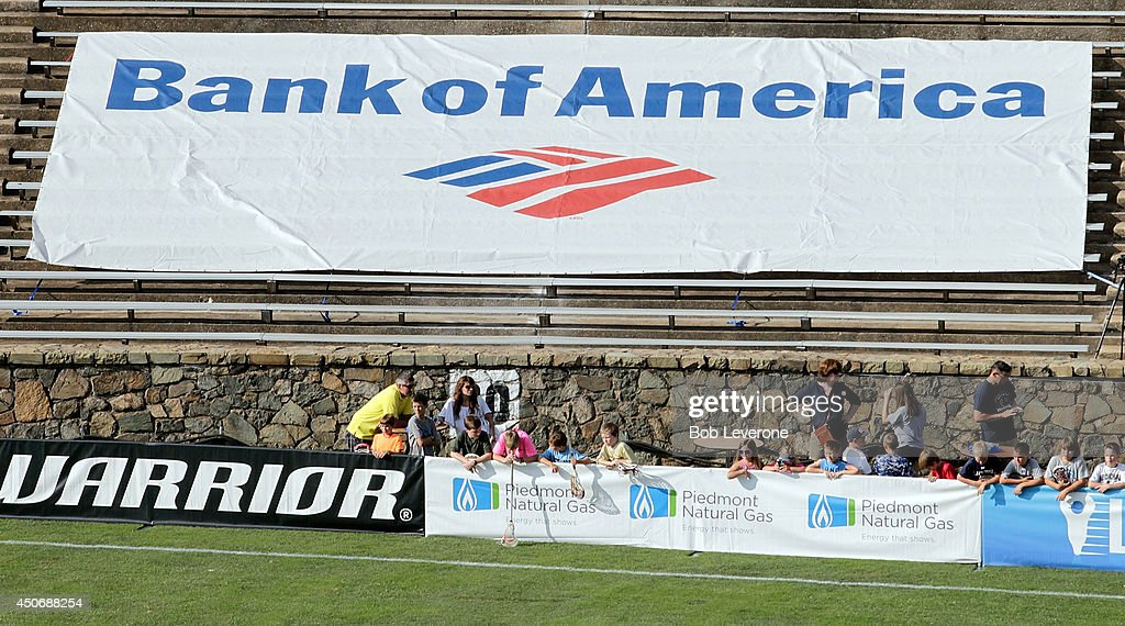Sponsor signs hang from the stadium walls before a match between the Florida Launch and Charlotte Hounds at American Legion Memorial Stadium on June...