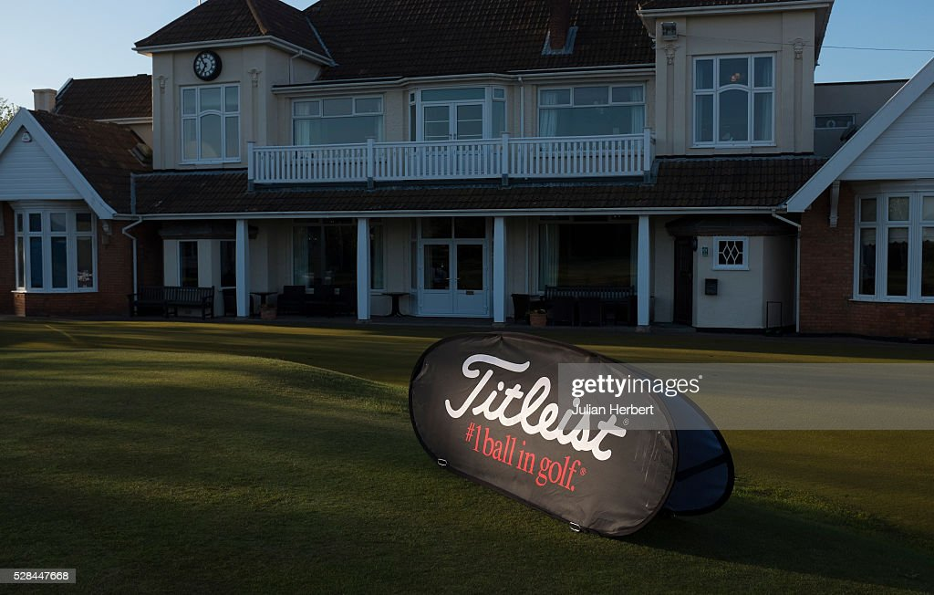 A sponsors branding board is hit by the rising sun by the clubhouse during the PGA Professional Championship - West Qualifier at Burnham And Berrow Golf Club Club on May 5, 2016, in Burnham-On-Sea, England.