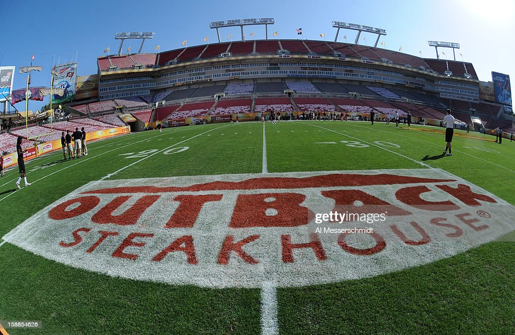 A sponsor's logo is seen on the field before the Michigan Wolverines play against the South Carolina Gamecocks in the Outback Bowl January 1 2013 at...