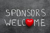 sponsors welcome phrase handwritten on chalkboard with heart symbol instead of O