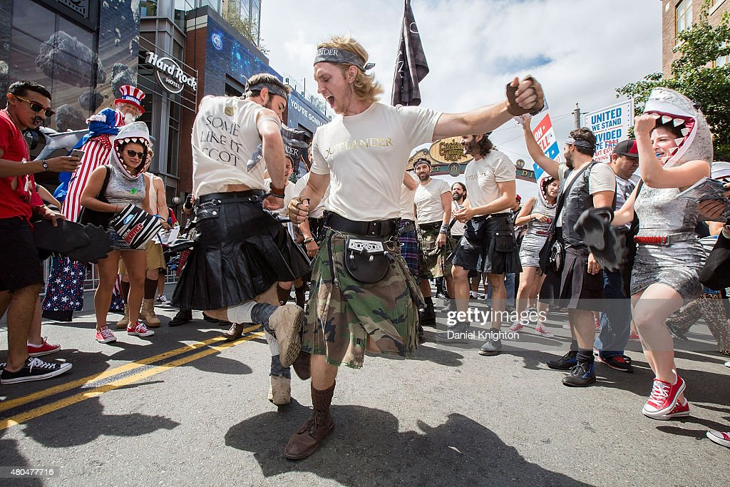 A spontaneous dance-off occured between the promoters of Sharknado 3 and Outlanders on 5th Avenue outside Comic-Con International at San Diego Convention Centeron July 11, 2015 in San Diego, California.