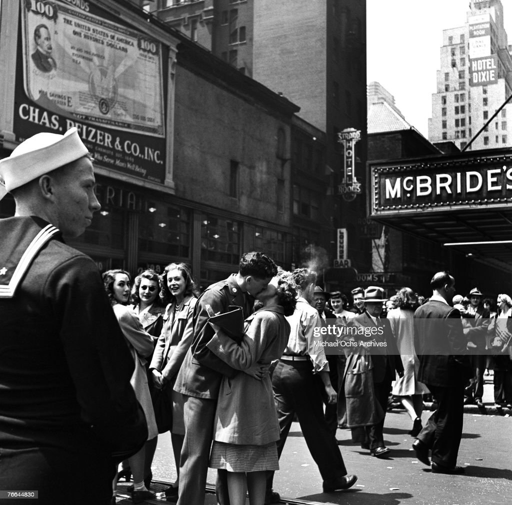 Spontaneous displays of affection between servicemen and strangers on the street mark V-E Day (or 'Victory in Europe' Day) on May 8, 1945, in New York, New York. V-E Day signalled the end of hostilities in the European theater in World War II.