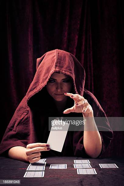 spooky fortune teller with tarot cards