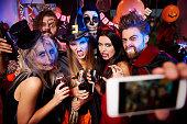 Spooky friends posing on the selfie