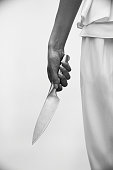 Spooky image of knife and woman's hand