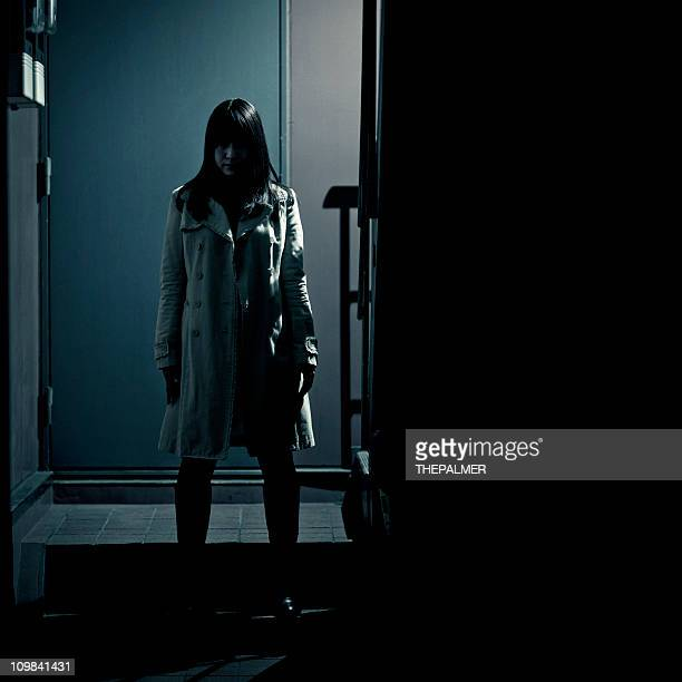 spooky japanese girl at the entrance of building