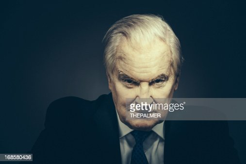 spooky senior businessman