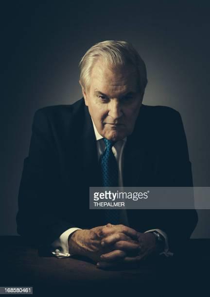 spooky senior businessman