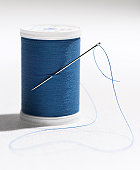 Spool of Blue Thread and Needle