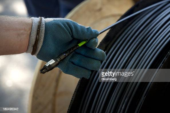 A spool of fiber optic cable is displayed for a photograph during installation in Minneapolis Minnesota US on Thursday Sept 11 2013 The US Internet...