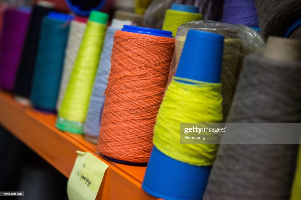 Spools of cashmere thread sit on a shelf at a Bodios Co. garment factory in Ulaanbaatar, Mongolia, on Wednesday, March 15, 2017. Mongolia's gross domestic product is expected to expand eight percent by 2019, and then grown at around five to six percent after that, International Monetary Fund (IMF) Mission Chief for Mongolia, Koshy Mathai, said in an interview last month with Bloomberg Mongolia TV. Photographer: Taylor Weidman/Bloomberg via Getty Images
