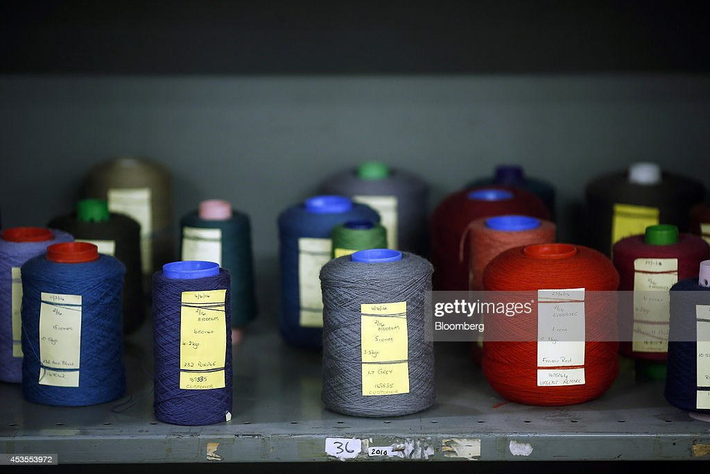 Spools of freshly died yarn sit on a storage shelf ahead of use in tartan production at Lochcarron John Buchan Ltd.'s plant in Selkirk, U.K., on Tuesday, Aug. 12, 2014. Scottish nationalists seeking independence from the U.K. lost ground in the latest poll of voting intentions for the Sept. 18 referendum, as campaigners to keep the 307-year-old U.K. intact extended their lead. Photographer: Simon Dawson/Bloomberg via Getty Images