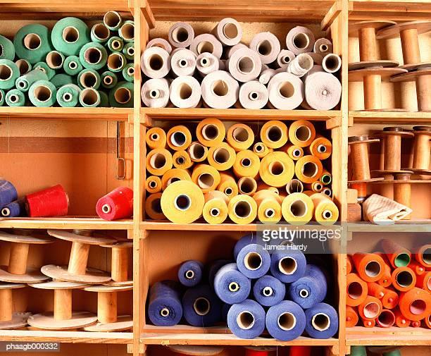 Spools of weaving thread on shelves
