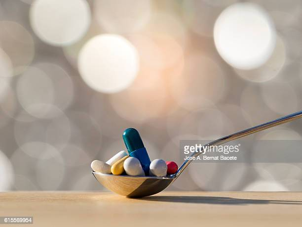 Spoon fills of medicines, tablets and pills