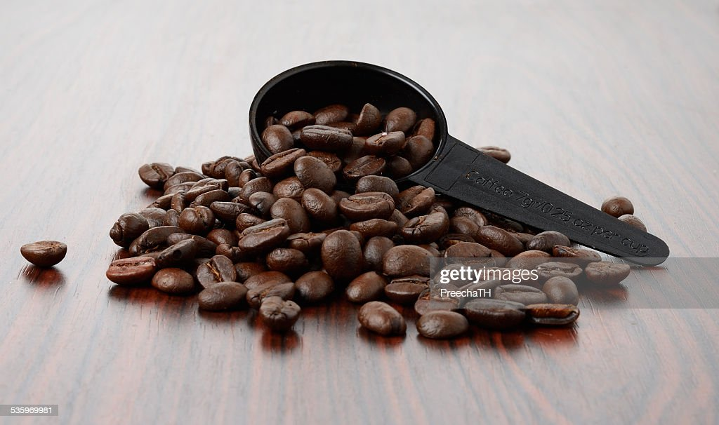 Spoon of coffee bean on wood texture isolated : Stock Photo