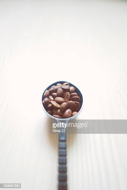A spoon of coffee beans