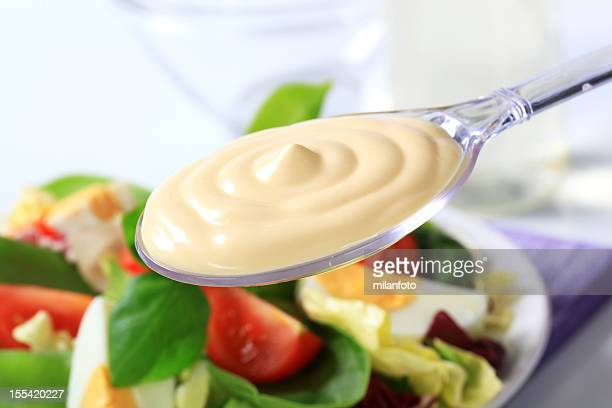 Spoon of mayonnaise and salad