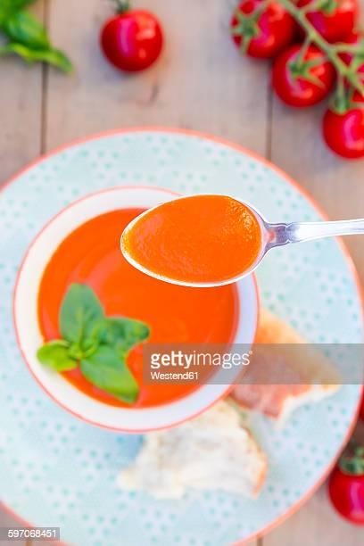 Spoon of tomato cream soup