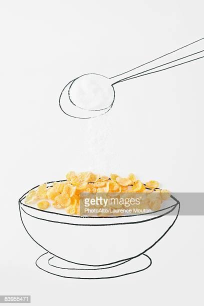 Spoon sprinkling sugar on bowl of cereal