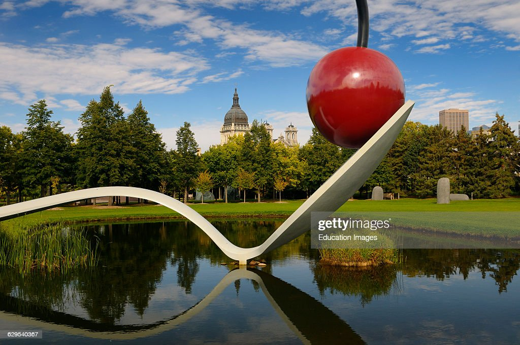 Spoonbridge And Cherry Over A Pond In Minneapolis Sculpture Garden With  Saint Mary Basilica.