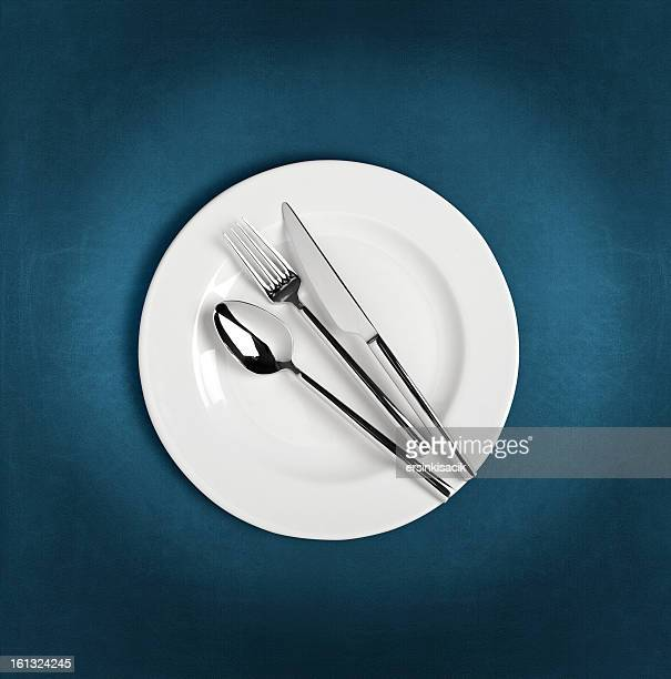 Spoon,fork and Table knife on dinner plate