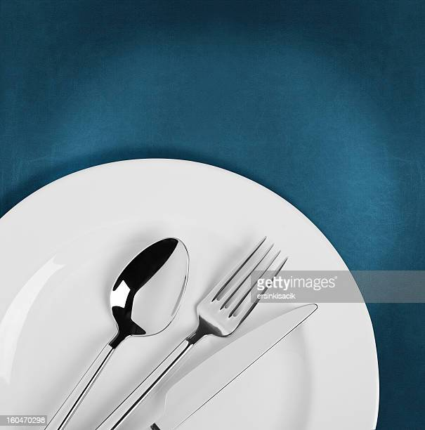 Spoon,fork and Table knife on White plate