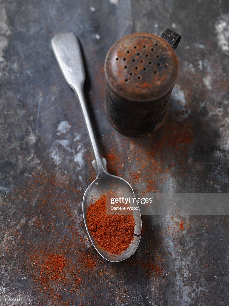 Spoonful of paprika spice on countertop : Stock Photo