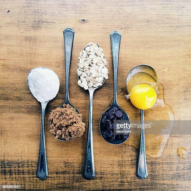 Spoons with cookie ingredients
