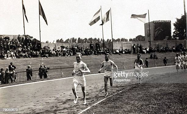 Sport 1924 Olympic Games Paris France000 metres team race Paavo Nurmi and Ville Ritola leading Finland to the Gold medal ahead of Great Britain and...