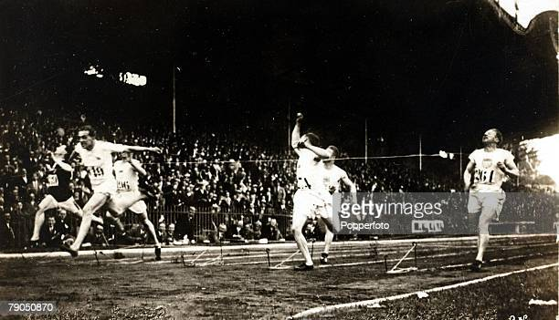 Sport 1924 Olympic Games Paris France Mens 100 metres final British athlete Harold Abrahams 2nd left wins the Gold medal ahead of Jackson Scholz USA...