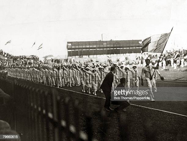 Sport 1924 Olympic Games Paris France The Opening Ceremony as the French team behind the Tricolor march past the Grandstand