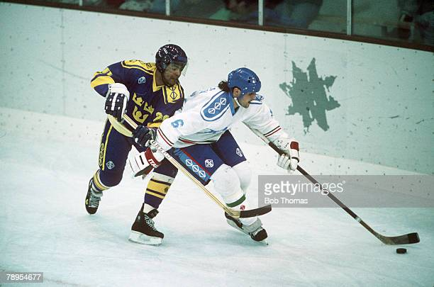Sport 1992 Winter Olympic Games Albertville France Ice Hockey Italy v Sweden Italy's Jimmy Camazzola holds off a Swedish challenge