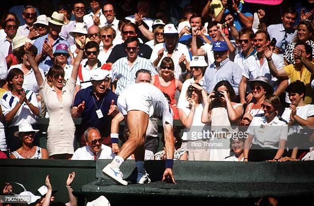 Sport AllEngland Lawn Tennis Championships Wimbledon London England Mens Singles Final Australia's Pat Cash climbs into the stands to celebrate his...