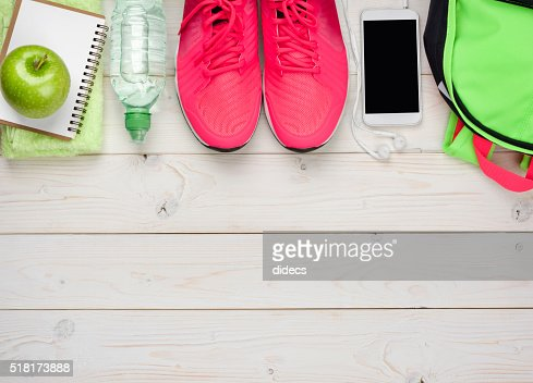 Sport and fitness concept on wooden planks background : Stock Photo