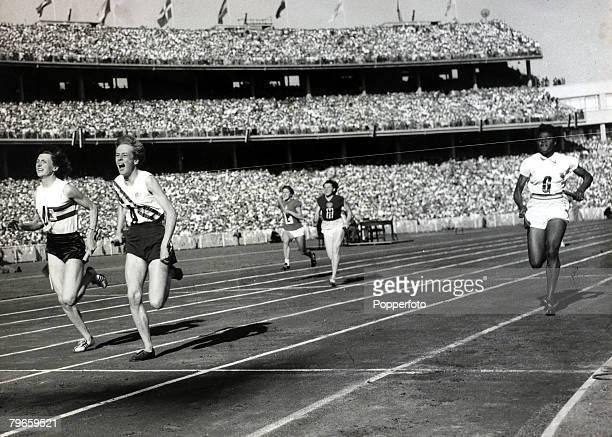 Sport Athletics 1956 Olympic Games Melbourne Australia Womens 4 x100 metres Final Australia's Betty Cuthbert beats Great Britain's Heather Armitage...