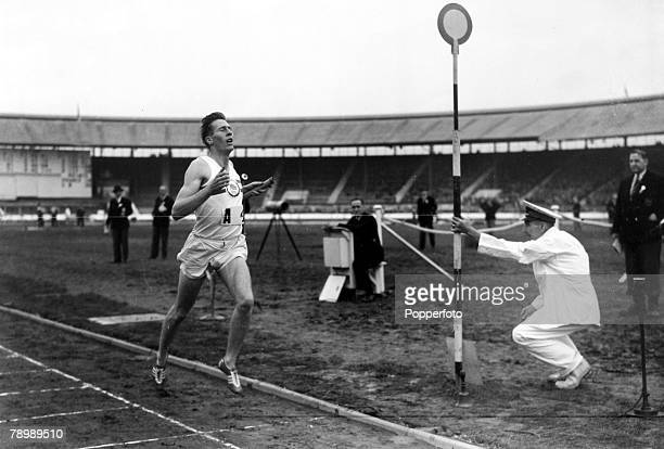 1st August 1953 White City London Roger Bannister finishes the last leg of the one mile relay setting a new mile record in a time of 16 minutes 41...