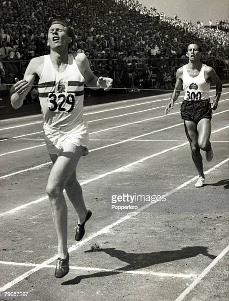 7th August 1954 British Empire Games in VancouverGreat Britain's Roger Bannister leads Australia's John Landy breaking the tape to win the Mile event...