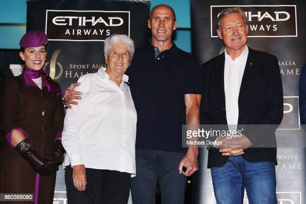 Sport Australia Hall of Fame Inductee and legend AFL footballer Tony Lockett poses with sporting legends Dawn Fraser and John Bertrand at the...