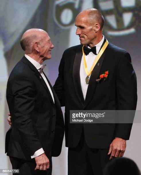 Sport Australia Hall of Fame Inductee and legend AFL footballer Tony Lockett is seen on stage with AFL legend Kevin Bartlett at the Annual Induction...